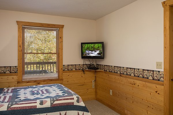 TV in the fourth bedroom at Southern Comfort Inn, a 4 bedroom cabin rental located in Pigeon Forge