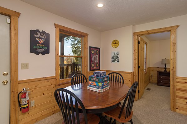 Game room with board games at Southern Comfort Inn, a 4 bedroom cabin rental located in Pigeon Forge