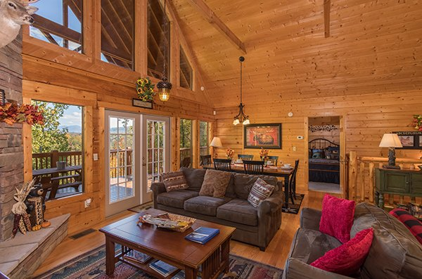 Main floor with living and dining space at Southern Comfort Inn, a 4 bedroom cabin rental located in Pigeon Forge