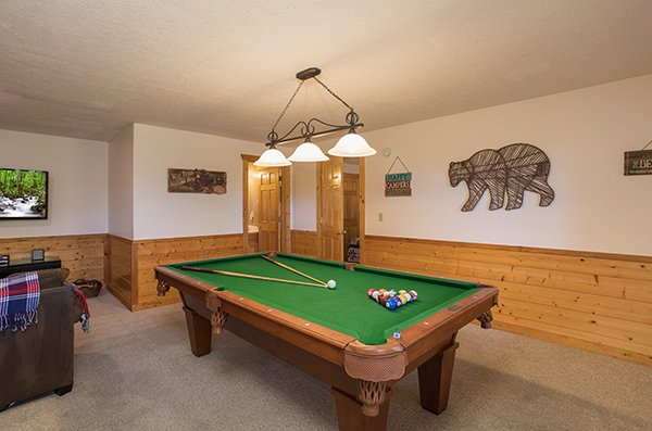 Pool table at Southern Comfort Inn, a 4 bedroom cabin rental located in Pigeon Forge