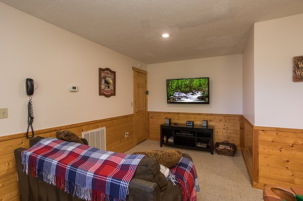 Sofa bed and TV on the lower level at Southern Comfort Inn, a 4 bedroom cabin rental located in Pigeon Forge