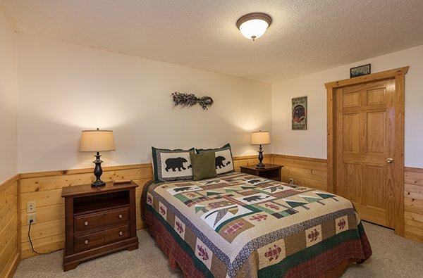 Bedroom with a queen bed at Southern Comfort Inn, a 4 bedroom cabin rental located in Pigeon Forge