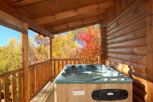 Hot tub on covered deck at A Lover's Secret a 1 bedroom cabin rental located in Gatlinburg