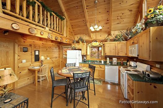 Fully stocked kitchen and dining area for four at A Lover's Secret a 1 bedroom cabin rental located in Gatlinburg