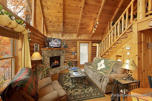 Living room with fireplace at at A Lover's Secret a 1 bedroom cabin rental located in Gatlinburg