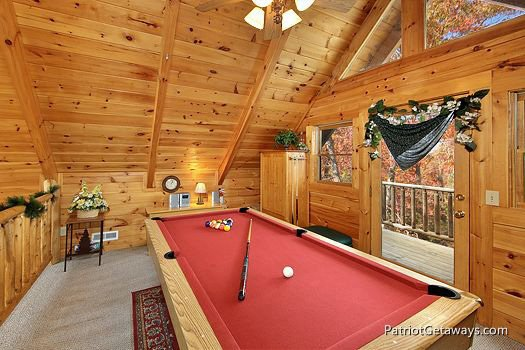 Pool table in lofted game room at A Lover's Secret a 1 bedroom cabin rental located in Gatlinburg