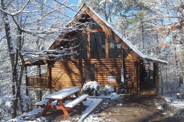 Snowy exterior at A Lover's Secret a 1 bedroom cabin rental located in Gatlinburg