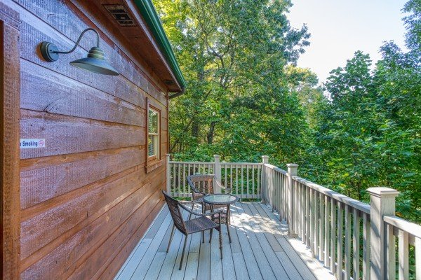 Bistro set on the deck at Mountain Life, a 1 bedroom cabin rental located in Pigeon Forge
