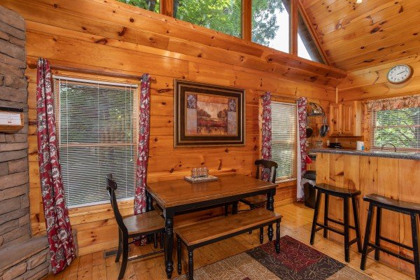 Dining table for four and counter seating for two at Mountain Life, a 1 bedroom cabin rental located in Pigeon Forge