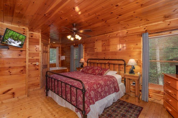 Bedroom with a king bed at Mountain Life, a 1 bedroom cabin rental located in Pigeon Forge