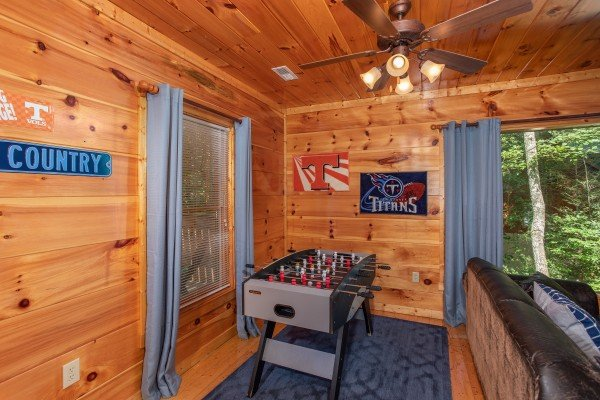 Foosball table in the game room at Mountain Life, a 1 bedroom cabin rental located in Pigeon Forge