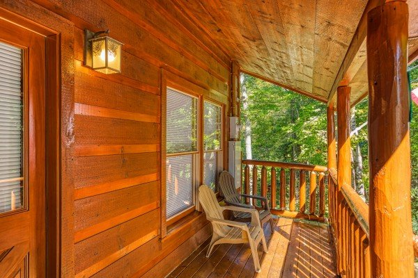 Front porch with two Adirondack chairs at Mountain Life, a 1 bedroom cabin rental located in Pigeon Forge