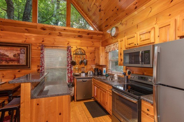 Kitchen with stainless appliances at Mountain Life, a 1 bedroom cabin rental located in Pigeon Forge