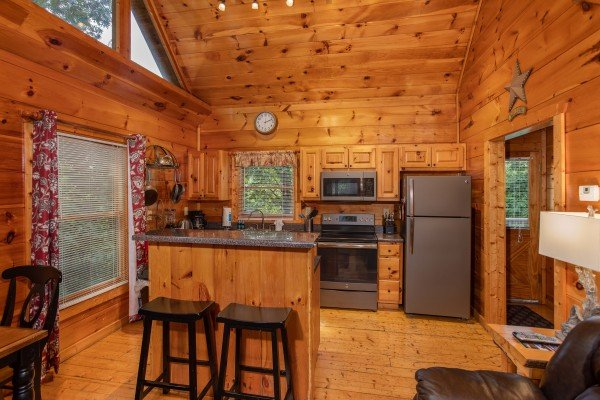 Kitchen with an island and stainless appliances at Mountain Life, a 1 bedroom cabin rental located in Pigeon Forge