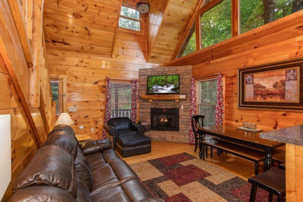 Open concept main floor with living room, dining space, and kitchen at Mountain Life, a 1 bedroom cabin rental located in Pigeon Forge