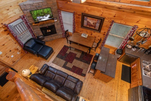 Looking down into the living room at Mountain Life, a 1 bedroom cabin rental located in Pigeon Forge
