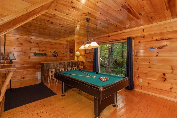 Pool table in the game room at Mountain Life, a 1 bedroom cabin rental located in Pigeon Forge