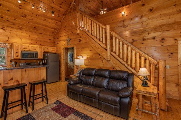 Sofa in the living space at Mountain Life, a 1 bedroom cabin rental located in Pigeon Forge