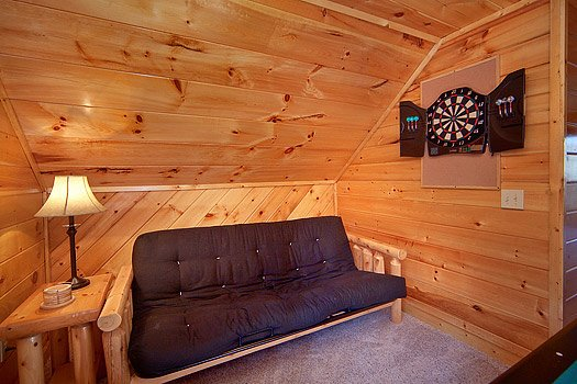 Futon in the game room at Hidden Pleasure, a 1-bedroom cabin rental located in Gatlinburg