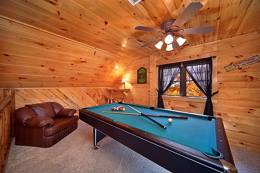 Pool table in the game room at Hidden Pleasure, a 1-bedroom cabin rental located in Gatlinburg