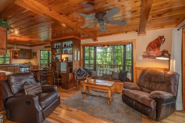 Chairs, sofa, and coffee table in the living roomat Hidden Pleasure, a 1-bedroom cabin rental located in Gatlinburg