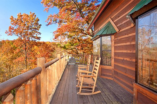Rocking chairs on the deck at Hidden Pleasure, a 1-bedroom cabin rental located in Gatlinburg
