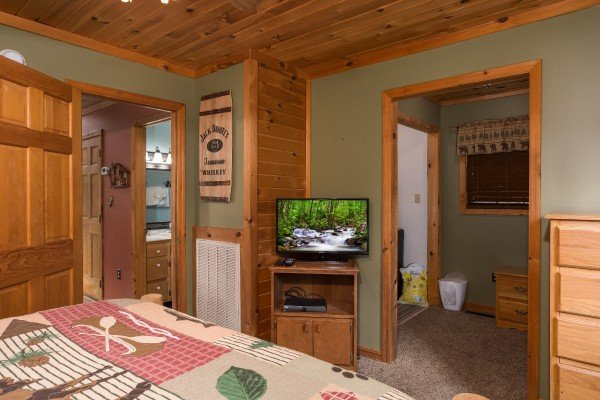 television in a bedroom at a little slice of heaven a 1 bedroom cabin rental located in pigeon forge