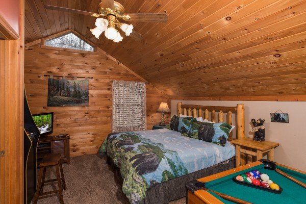 bed in the game room at a little slice of heaven a 1 bedroom cabin rental located in pigeon forge