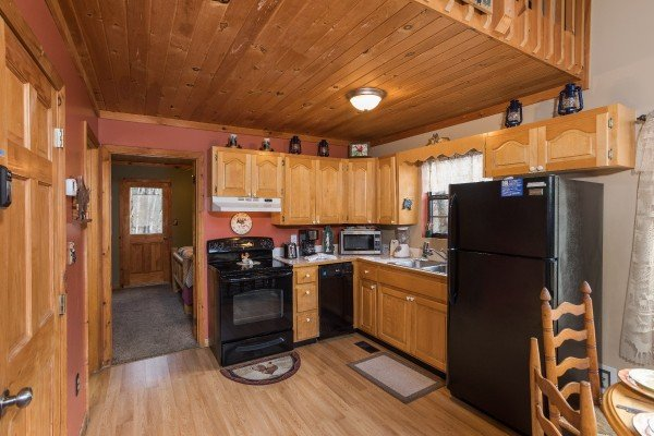 kitchen with appliances at a little slice of heaven a 1 bedroom cabin rental located in pigeon forge