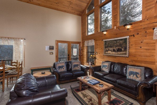 living room with couch loveseat and chair at a little slice of heaven a 1 bedroom cabin rental located in pigeon forge
