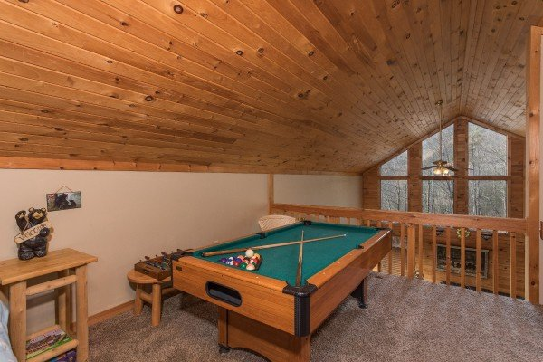 pool table in a loft space at a little slice of heaven a 1 bedroom cabin rental located in pigeon forge