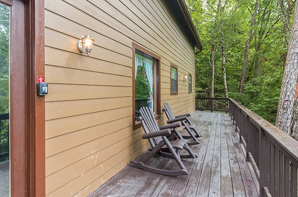 rocking chairs on a deck at a little slice of heaven a 1 bedroom cabin rental located in pigeon forge