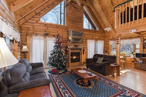 Living room at Christmas time at Sierra's Mountain Retreat, a 2 bedroom cabin rental located in Pigeon Forge