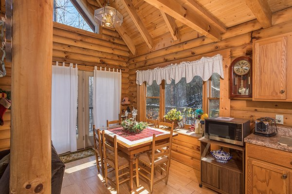 Dining table for six at Sierra's Mountain Retreat, a 2 bedroom cabin rental located in Pigeon Forge