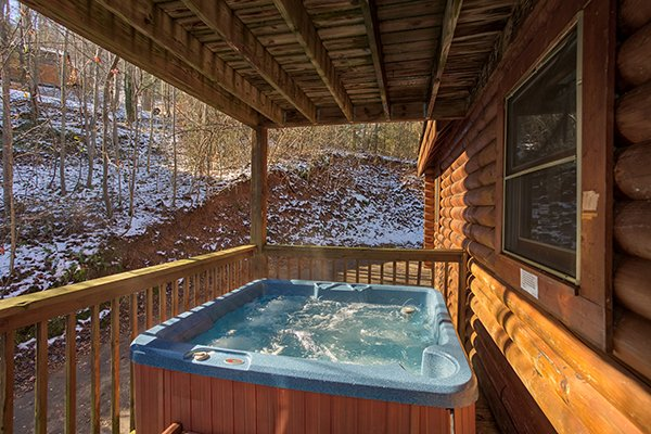Hot tub on a covered deck at Sierra's Mountain Retreat, a 2 bedroom cabin rental located in Pigeon Forge