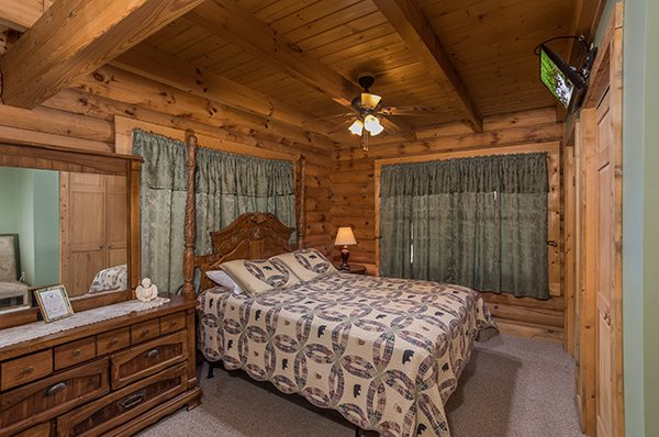 Bedroom in the loft with a dresser and TV at Sierra's Mountain Retreat, a 2 bedroom cabin rental located in Pigeon Forge