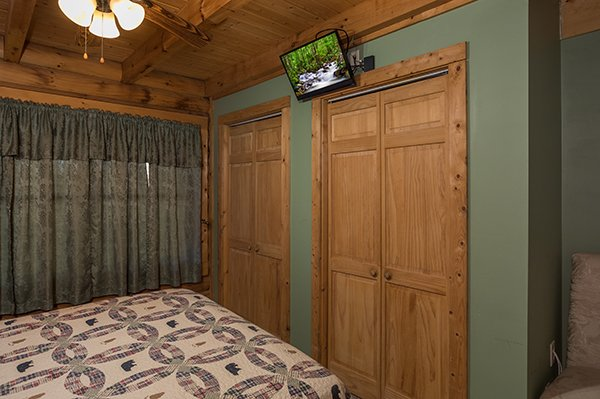 Closets and TV in the loft bedroom at Sierra's Mountain Retreat, a 2 bedroom cabin rental located in Pigeon Forge
