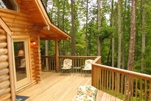 Main level back deck at Sierra's Mountain Retreat, a 2 bedroom cabin rental located in Pigeon Forge