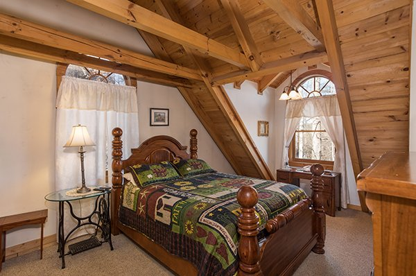 Bedroom on the upper floor at Sierra's Mountain Retreat, a 2 bedroom cabin rental located in Pigeon Forge