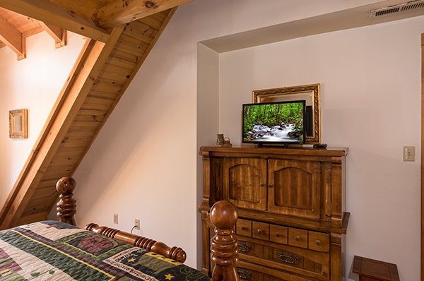 Armoire and TV in the loft bedroom at Sierra's Mountain Retreat, a 2 bedroom cabin rental located in Pigeon Forge