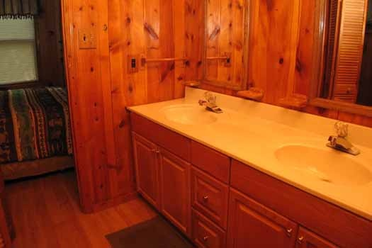 Double vanity sinks in bathroom at Heavenly Hideaway, a 2-bedroom cabin rental located in Gatlinburg