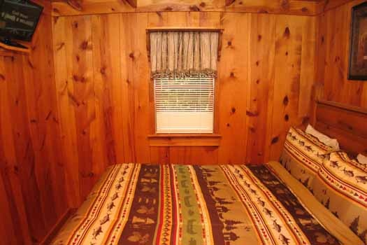 Queen bed in bedroom at Heavenly Hideaway, a 2-bedroom cabin rental located in Gatlinburg