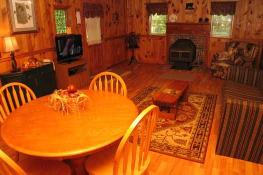 dining area with table for four at heavenly hideaway a 2 bedroom cabin rental located in gatlinburg
