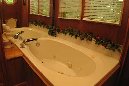 jacuzzi tub in bathroom at heavenly hideaway a 2 bedroom cabin rental located in gatlinburg