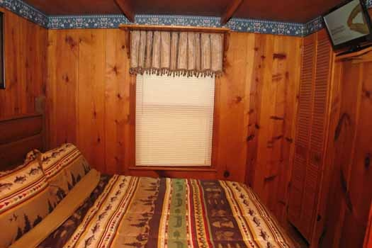 Queen sized bed in bedroom at Heavenly Hideaway, a 2-bedroom cabin rental located in Gatlinburg