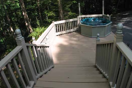 Steps down to hot tub on deck at Heavenly Hideaway, a 2-bedroom cabin rental located in Gatlinburg