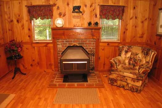 Wood burning stove fireplace at Heavenly Hideaway, a 2-bedroom cabin rental located in Gatlinburg