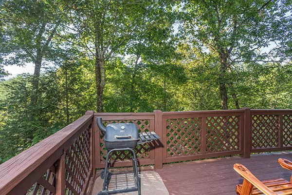 Charcoal grill on a deck at Cabin in the Woods, a 1-bedroom cabin rental located in Pigeon Forge