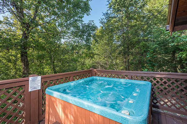 Hot tub on the deck at Cabin in the Woods, a 1-bedroom cabin rental located in Pigeon Forge