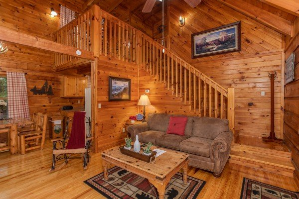 Living room with a sofa and rocker at Cabin in the Woods, a 1-bedroom cabin rental located in Pigeon Forge